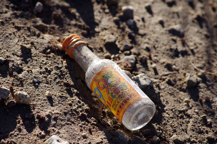 liquour bottle in the road