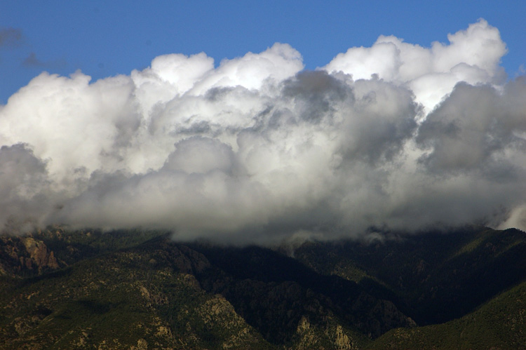 Post-storm clouds lingering over Taos Mountain